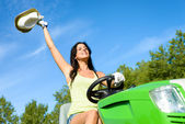 Happy gardener working with garden tractor — Stock Photo
