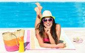 Fun summer vacation at pool — Stock Photo