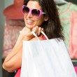 Woman shopping in the sales — Stock Photo