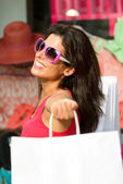 Blissful woman shopping in the sales — Stock Photo