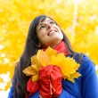 Dreamy woman on autumn sunshine day — Stock Photo