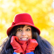 Happy autumn woman shivering — Stock Photo