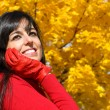 Dreamy woman on autumn in park — Stock Photo