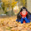 Happy woman thinking in autumn outdoors — Stock Photo