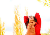 Blissful and joyful woman in autumn — Stock Photo