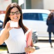 Woman showing business card for car sales — Stock Photo