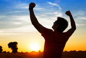 Sportsman with arms up celebrating success — Stock Photo