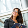 Successful businesswoman taking notes — Stock Photo