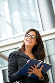 Successful businesswoman taking notes — Stockfoto