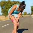 Stock Photo: Running knee injury and pain
