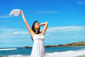 Happy woman on beach travel and vacation — Stock Photo