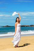 Joyful woman on beach vacation — Stock Photo