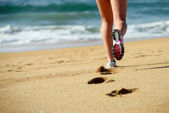 Running on beach — Stock Photo