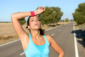 Tired woman sweating after running — Stock Photo