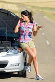 Woman calling to car insurance service — Stock Photo