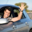 Man driving car on road — Stock Photo #34645129