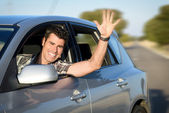 Man driving car on road — Stock Photo