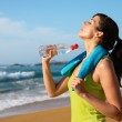 Woman drinking after running — Stock Photo