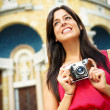 Woman taking photos in Europe — Stock Photo