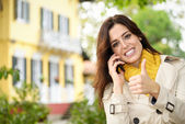 Positive female home owner calling by phone — Stock Photo
