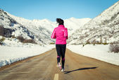 Running in road on cold winter — Stock Photo