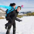 Fun hiking couple in winter — Stock Photo
