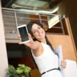 Casual businesswoman showing cellphone — Stock Photo