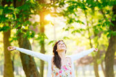 Woman enjoying happiness and hope on spring — Stock Photo