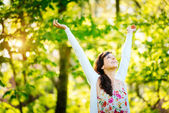 Blissful woman enjoying freedom on spring — Stock Photo