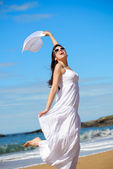 Playful woman dancing on beach — Stock Photo