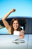 Successful girl passing car driving license test — Stock Photo