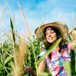Beautiful female farmer in corn field — Stock Photo #43978103
