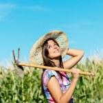 Successful female farmer in corn field — Stock Photo
