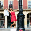 Woman dancing after shopping in spain — Stock Photo #43979903