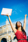 Successful student raising arms — Stock Photo