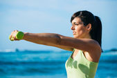 Fitness woman workout with dumbbells outdoor — Stock Photo