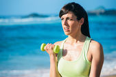 Fitness woman on beach workout — Stock Photo
