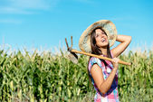 Happy female farmer in corn field — Stock Photo