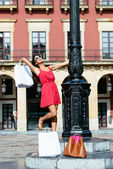 Woman dancing after shopping in spain — Photo
