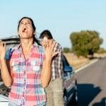 Desperate woman suffering car breakdown — Stock Photo #43983339