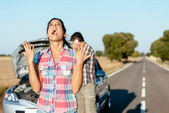 Desperate woman suffering car breakdown — Stock Photo
