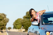 Woman on car roadtrip enjoying freedom — Stock Photo