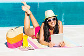 Woman on summer with digital tablet — Stock Photo