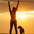 Successful fitness woman and dog — Stock Photo