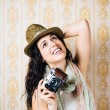 Hipster girl taking photo with vintage camera — Stock Photo