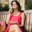 Businesswoman on coffee break with tablet device — Stock Photo