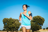 Sweaty woman running cross trail — Stock Photo