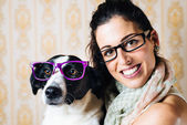 Funny woman and dog with glasses portrait — Stock Photo