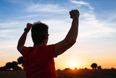 Male runner success at sunset — Stock Photo