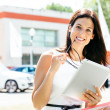 Car sales woman with tablet in trade show — Stock Photo #48869721